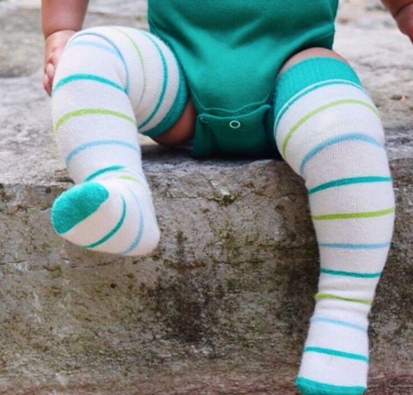 Socklings children's socks magically grow with your baby and can actually be worn all the way to adulthood. They grow as you grow!