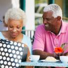 Elderly Couple Taking A Shopping Break