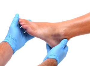 Doctor Holding A Foot