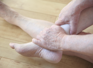 Person Experiencing Foot Pain