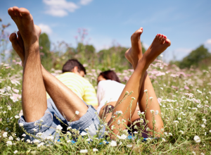 Barefoot Couple In A Field Of Spring Flowers