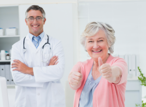 Doctor and Patient Giving A Thumbs Up Sign