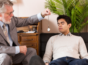 Man Being Hypnotized By A Hypnotherapist