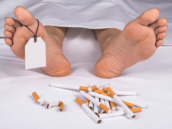 The Feet Of A Corpse Next To A Pile Of Cigarettes