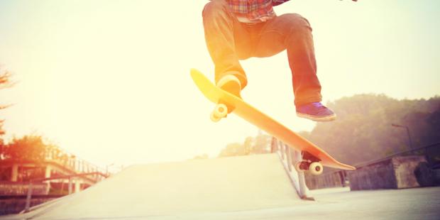 Teen Boy Doing A Skateboard Trick