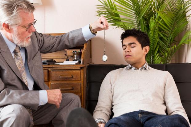 Man Being Hypnotized By A Hypnotherapist