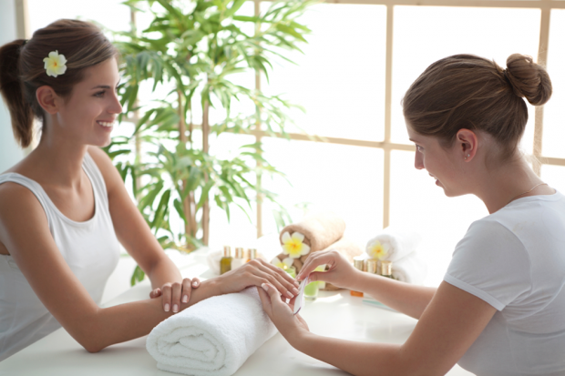 A Nail Tech Giving a Woman a Manicure