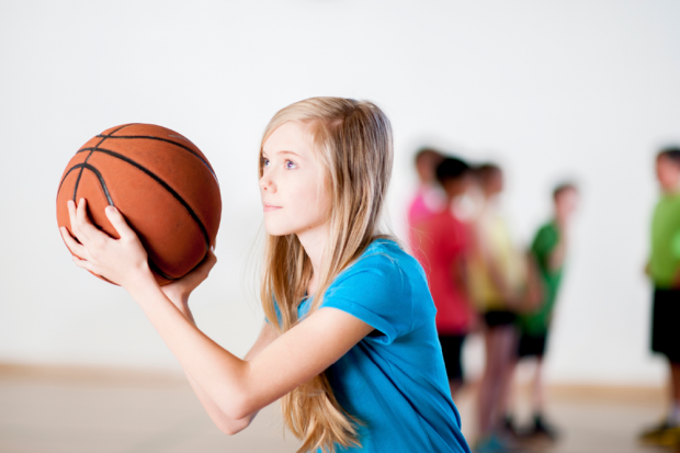 Young Girl Playing Basketball