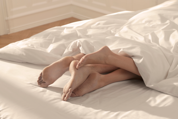 Foot sex while sleeping