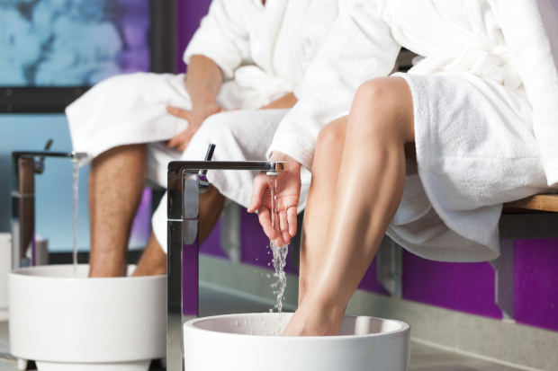 Couple Indulging In Hydrotherapy Foot Baths