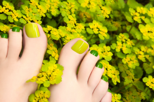Toes Painted Shades Of Green In A Field Of Yellow Flowers