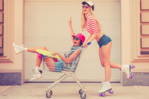 Two Girls Rollerskating Outside a Grocery Store